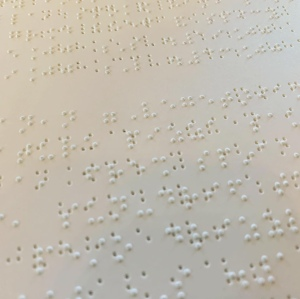 Closet up of braille on a white sheet