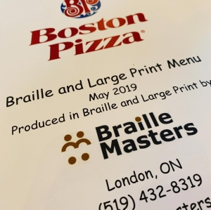 Cover of a braille / large print menu at Boston Pizza